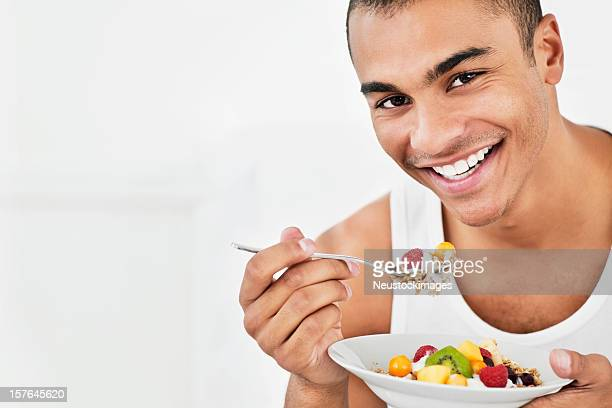 Young Man Eating Cereal