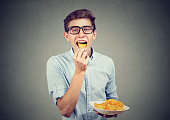 Young man eating potato chips