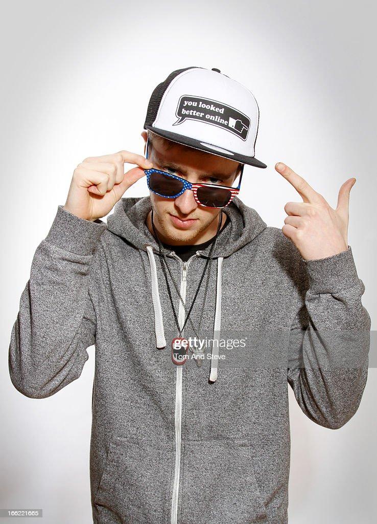 Young man embraces hip hop / gangsta culture