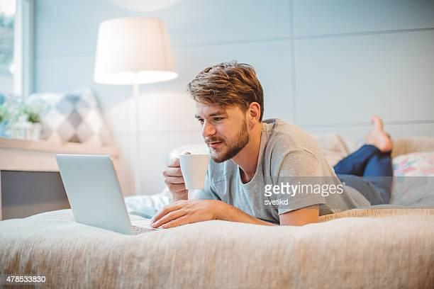 Young man enjoying at home.