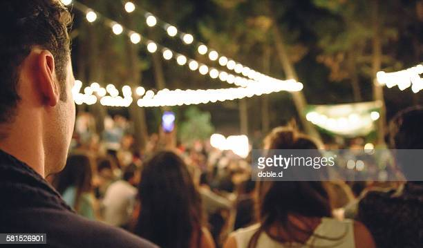 Young man enjoying in night music festival