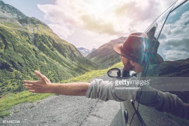 Young man enjoying road trip in Switzerland