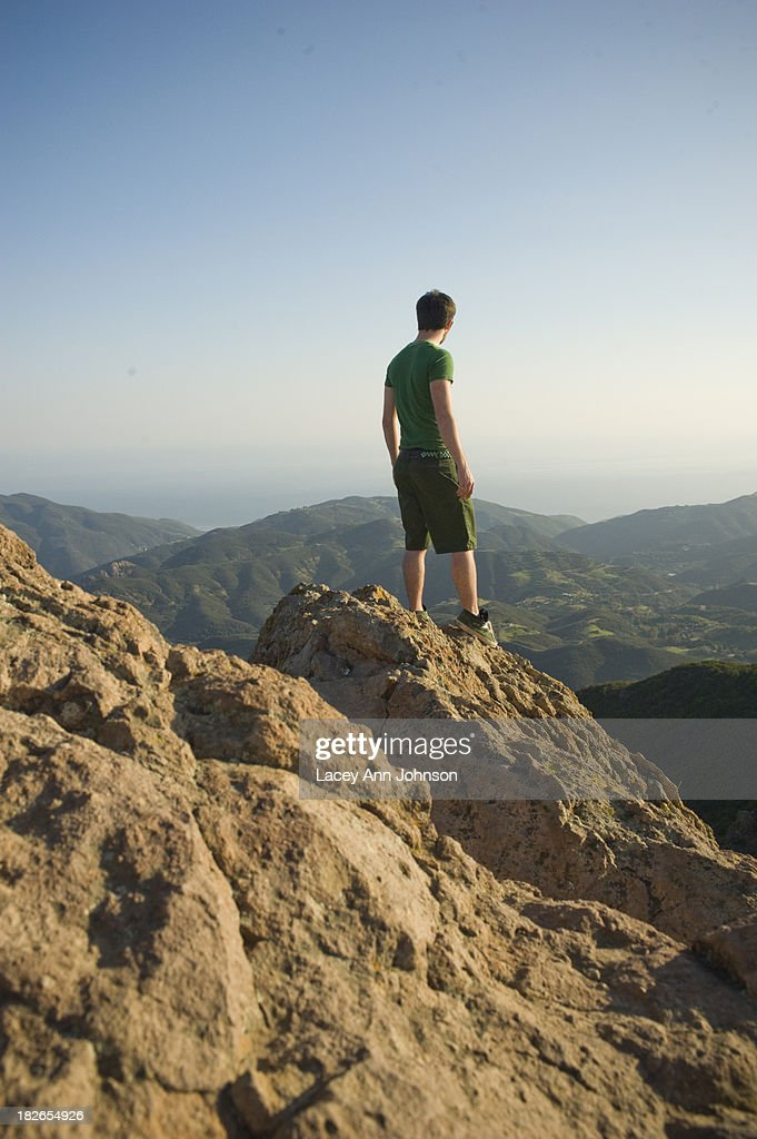 A young man enjoys a view of the Santa Monica Mountains in California.