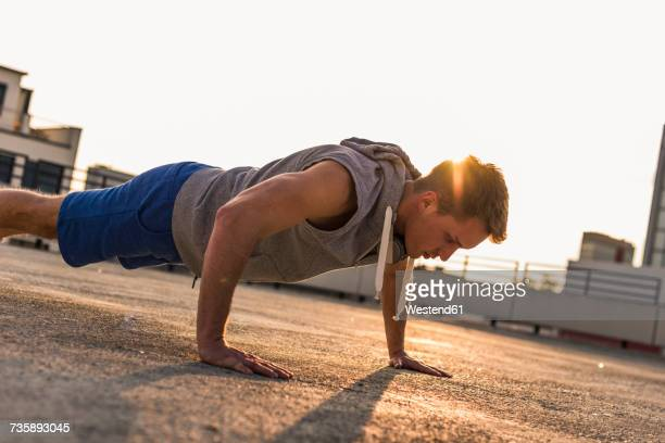 Young man exercing push ups