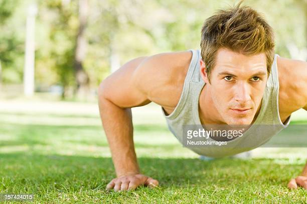 Young man exercising at park