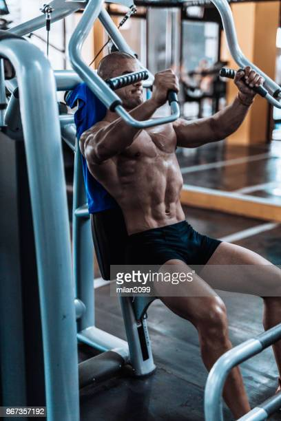 Young man exercising in the fym