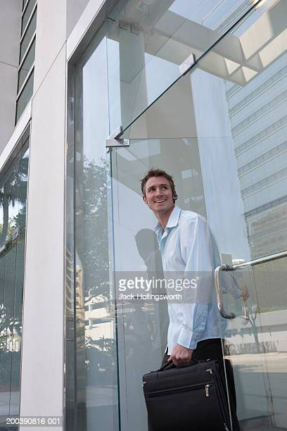 Young man exiting a building