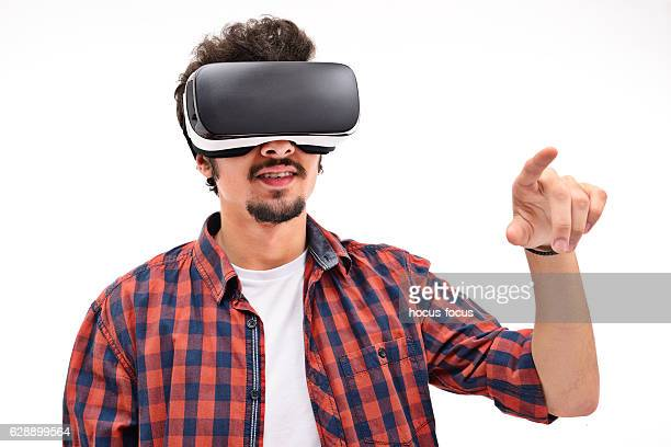 Young man experience with virtual reality headset