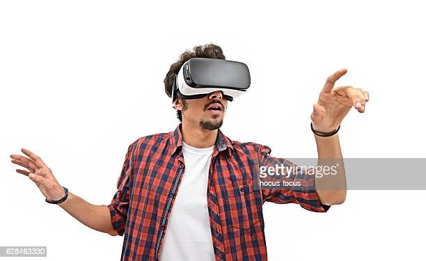 Young man experience with VR headset