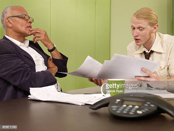 Young man explaining work to his manager