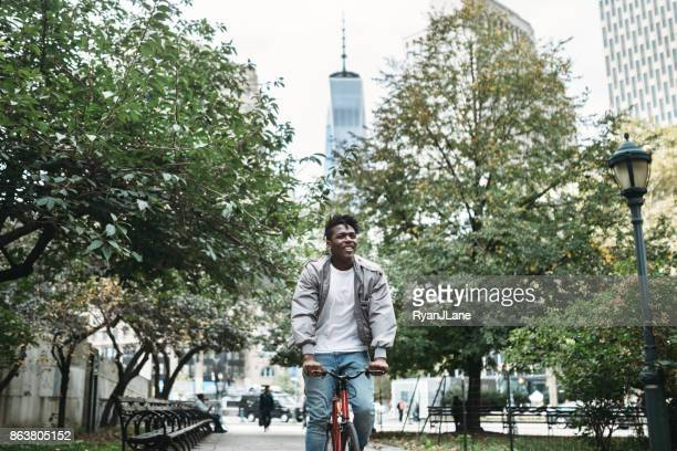 Young Man Exploring New York City by Bike