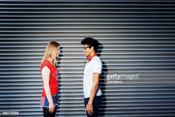 young man facing young woman