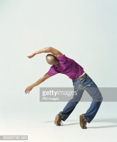 Young man falling backwards, rear view