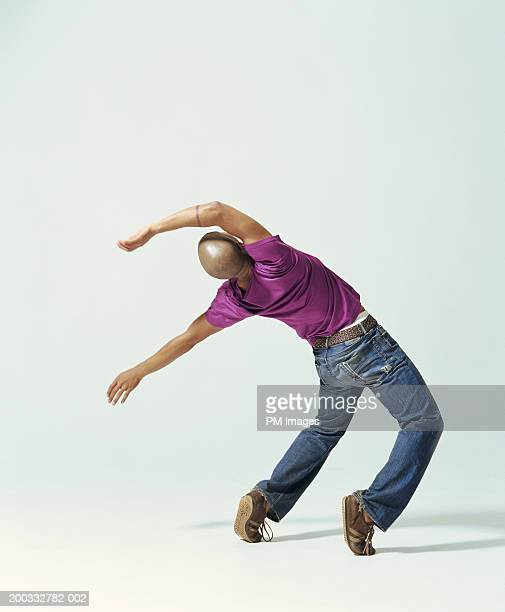 Young man falling backwards, rear view