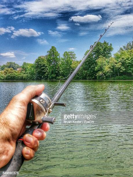 Young Man Fishing In River