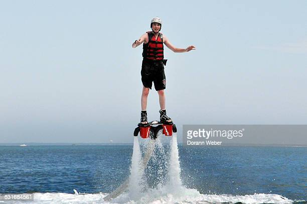 Young man fly boards in the Atlantic Ocean