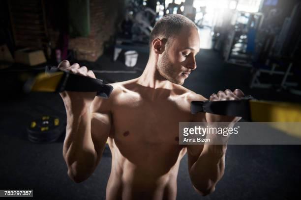 Young man focus on biceps. Mielec, Poland