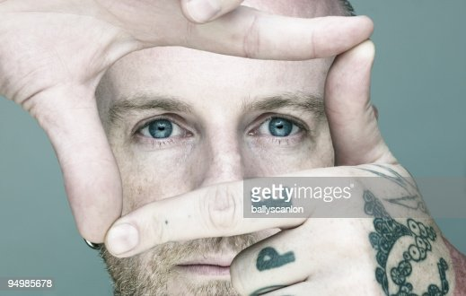 Young man Framing With Hands. : Stock Photo