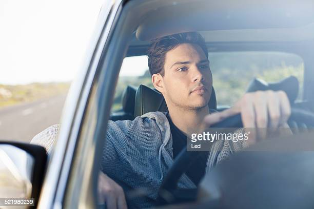 Young man gazing out of car windscreen, Cape Town, Western Cape, South Africa