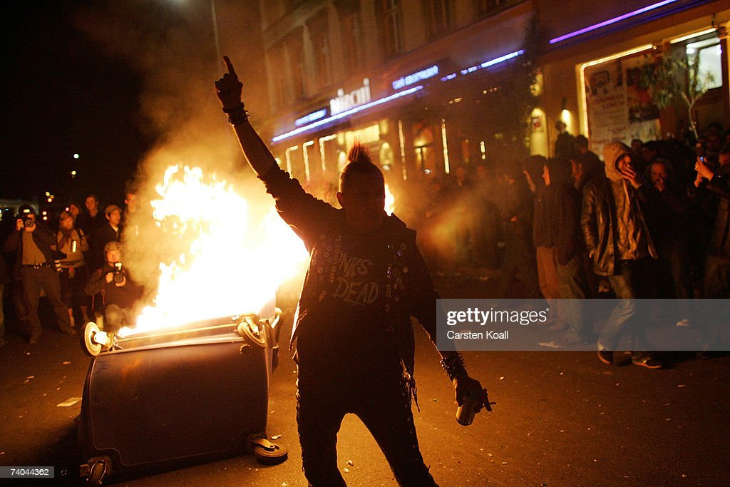 A young man gestures by a fire set by demonstrators during clashes between mostly leftwing protesters and police on May Day in the district of...
