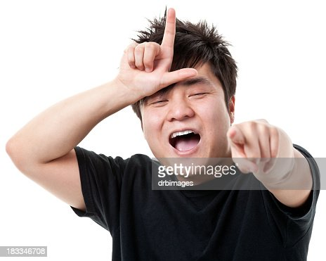 Young Man Gestures Loser L Hand Sign, Laughs, Points