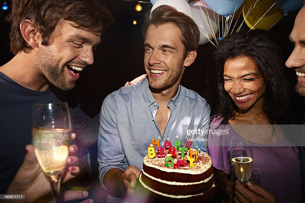 Young Man Getting Birthday Cake At Party Stock Photo Getty Images