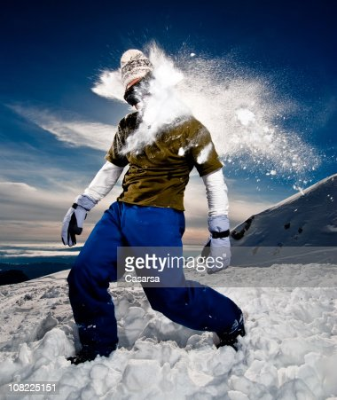 Young Man Getting Hit with Snowball on Mountains
