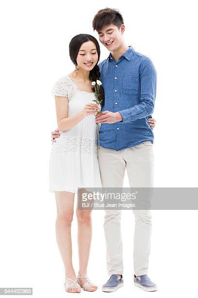 Young man giving flowers to his girlfriend