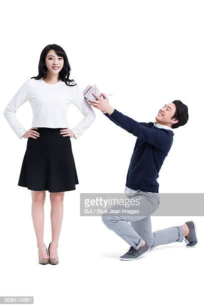 Young man giving girlfriend gift