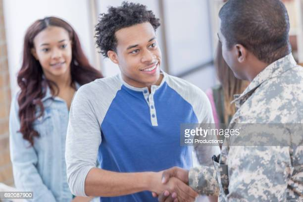 Young man greets military recruiter