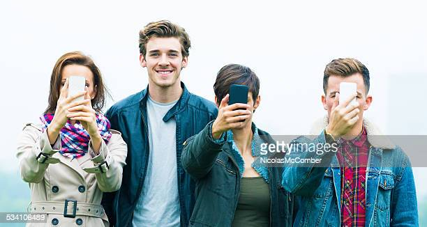 Young man happy to be without a mobile phone