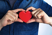A young man has a red heart shape on his chest by hand.(World heart day,Valentine's day,Love)