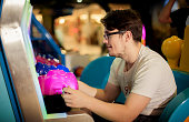 Happy young man playing games on the game room