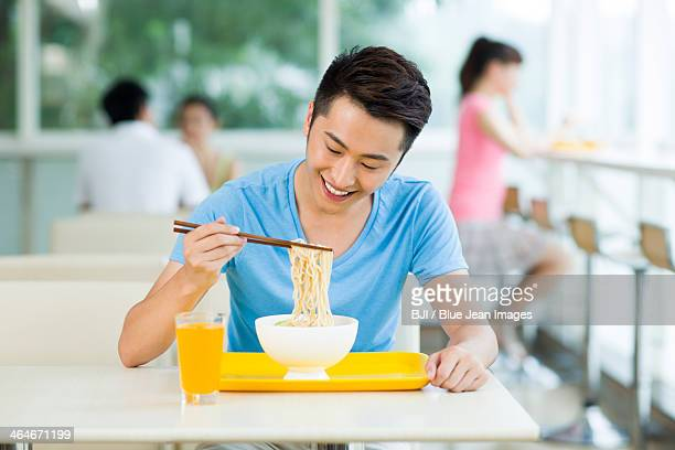 Young man having a meal in restaurant