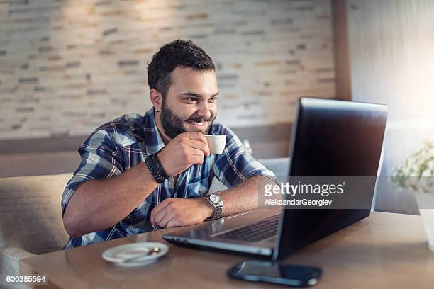 Young Man Having a Video Conference Coffee at Cafe