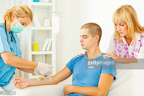 Young Man having Chemotherapy at home.