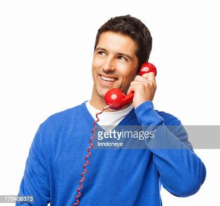 Giovane uomo avendo una conversazione al telefono-isolato