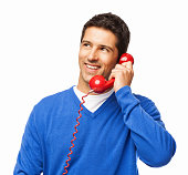 Young Man Having Conversation On Telephone - Isolated