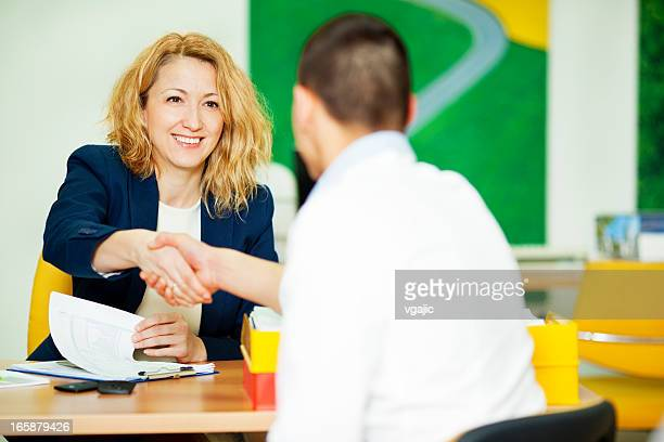 Young Man Having Meeting With Financial Advisor.