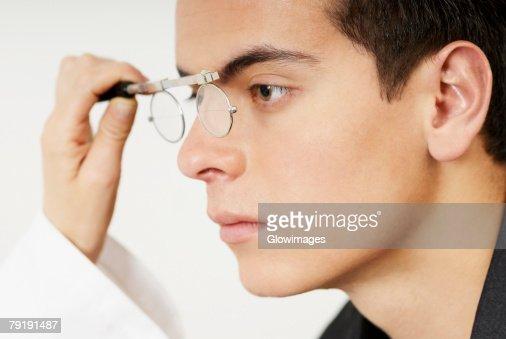 Young man having sight test : Foto de stock