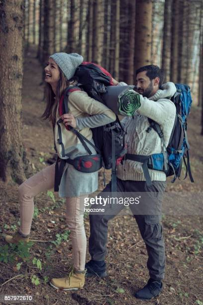 Young Man Helping His Girlfriend During a Hike