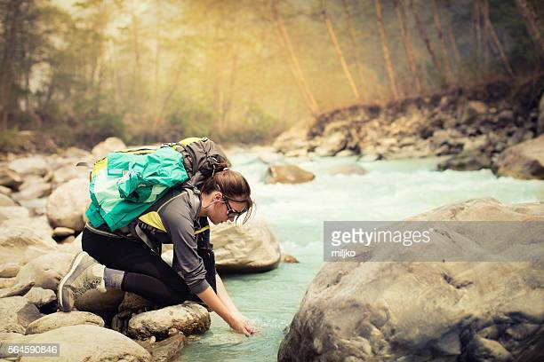 Young man hiking in nature by the river