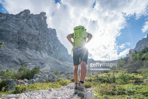 Young man hiking in the Dolomites, Alto Adige, Italy