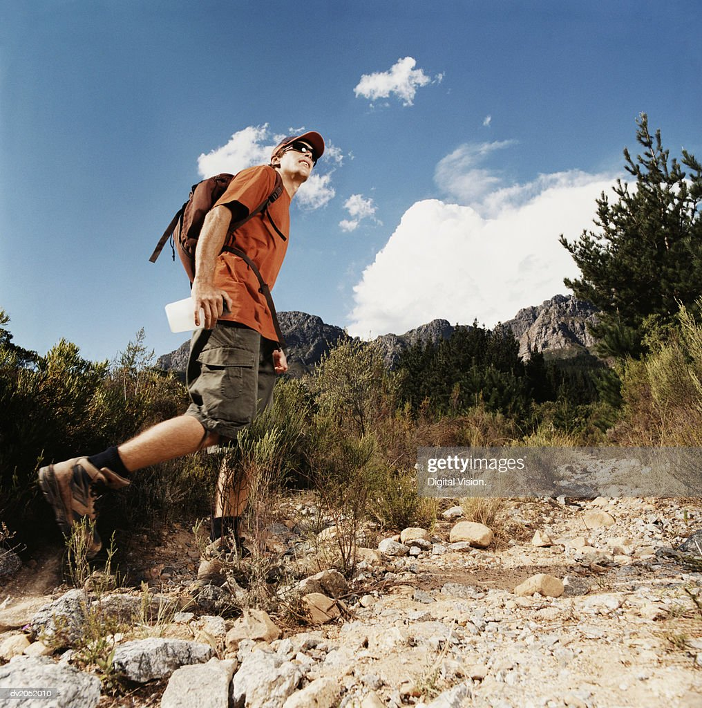 Young Man Hiking on a Mountain : Stock Photo