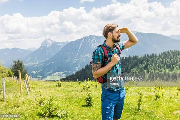 Young man hiking, Tyrol, Austria