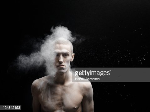 young man hit by cloud of white powder : ストックフォト