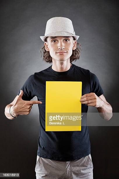 Young man holding a blank sign
