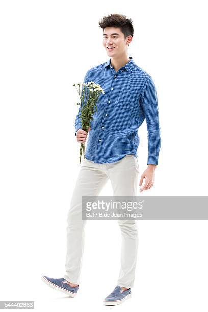 Young man holding a bunch of flowers