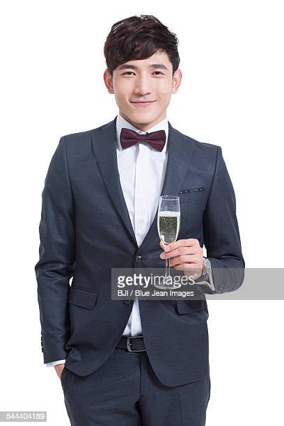 Young man holding a glass of champagne