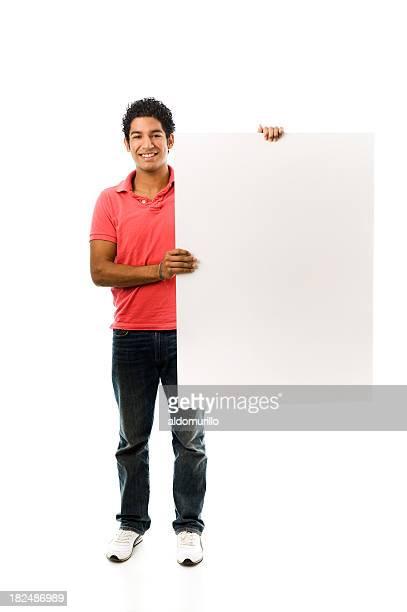 Junger Mann hält eine Weiße Tafel